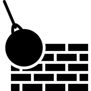 mur-de-briques-et-boule-de-demolition_318-62199
